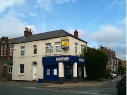 DOUBLE FRONTED RETAIL UNIT ON PROMINENT CORNER LOCATION (POSSIBLE A5 USES)