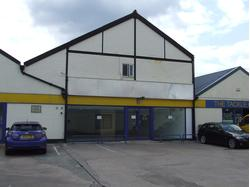 Retail warehouse with parking and rear loading facilities