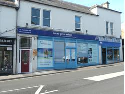 Ground floor retail unit occupying prominent roadside location in close proximity to the station.