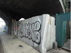 Enclosed piece of land situated under a railway arch to let on a  Tenancy at Will.