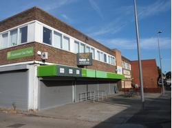Rare town centre freehold site with income
